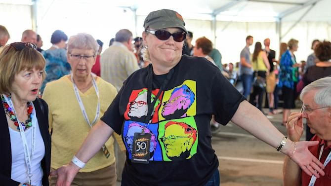 A Berkshire Hathaway shareholder wears a Warren Buffett T-shirt in the hospitality tent outside the Borsheims jewelry store, a Berkshire Hathaway subsidiary, in Omaha, Neb., Sunday, May 3, 2015.  The annual Berkshire shareholders weekend is coming to a close one day after more than 40,000 people attended a question and answer session with Warren Buffett and his Vice Chairman Charlie Munger. (AP Photo/Nati Harnik)