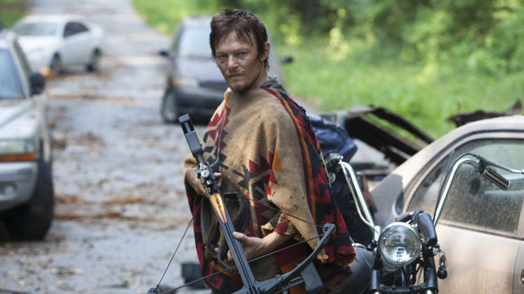 "This undated publicity photo provided by AMC shows Norman Reedus as Daryl Dixon in a scene from AMC's TV show, ""The Walking Dead,"" Season 3, Episode 5. The show airs Sundays at 9 p.m. EST on AMC. (AP Photo/AMC, Russell Kaye)"