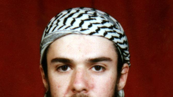 FILE - This undated file photo obtained from a religious school where he studied for five months in Bannu, near Islamabad, Pakistan, shows American-born Taliban fighter John Walker Lindh, an inmate at the federal prison in Terre Haute, Ind. American Civil Liberties Union of Indiana legal director Ken Falk, who helped Lindh and other Muslim inmates win the right to hold daily group prayers at the prison, said he'll ask a judge to order that they be allowed to pray together five times a day, as Islam requires. Since March 12, 2013, the prisoners have been allowed to pray three times per day. (AP Photo/File)