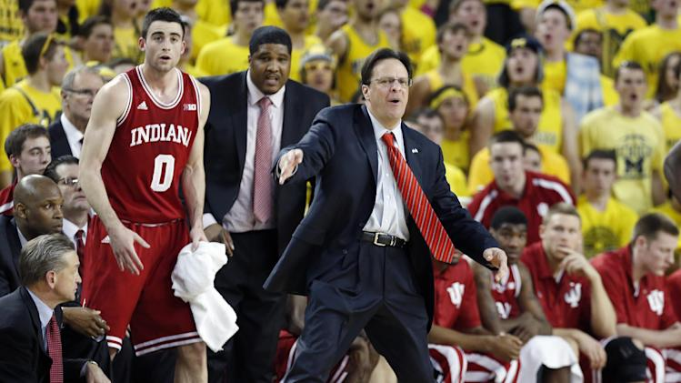 Indiana coach Tom Crean directs his team from the bench during the second half of an NCAA college basketball game against Michigan Sunday, March 10, 2013, in Ann Arbor, Mich. Indiana came from behind to defeat Michigan 72071 and capture their first outright Big Ten title in two decades. (AP Photo/Duane Burleson)
