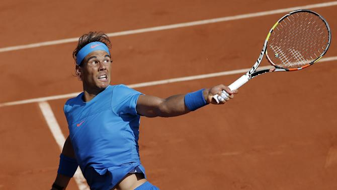 Spain's Rafael Nadal returns in the quarterfinal match of the French Open tennis tournament against Serbia's Novak Djokovic at the Roland Garros stadium, in Paris, France, Wednesday, June 3, 2015. (AP Photo/Christophe Ena)