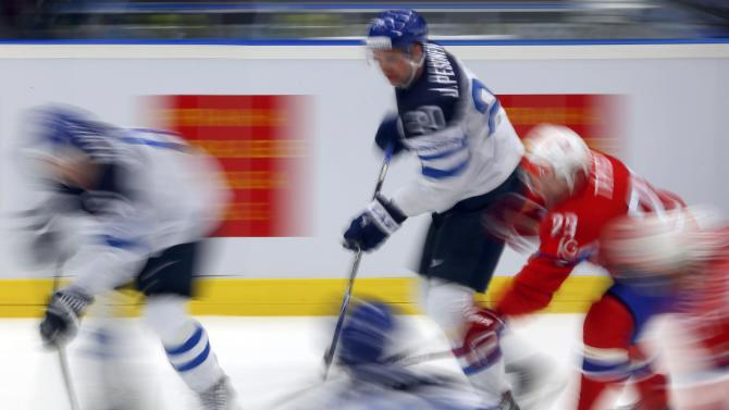 Norway's Trygg fights for the puck with Finland's Pesonen during their ice hockey World Championship game in Ostrava