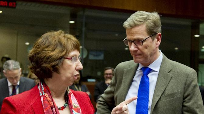 EU High Representative Catherine Ashton, left, speaks with German Foreign Minister Guido Westerwelle during a meeting of EU foreign ministers at the EU Council building in Brussels on Monday, Dec. 10, 2012. The 27 EU foreign ministers will discuss the situation in Syria, where activists say more than 40,000 people have died. (AP Photo/Virginia Mayo)