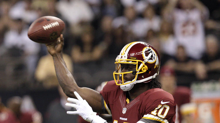 Washington Redskins quarterback Robert Griffin III (10) passes in the first half of an NFL football game against the New Orleans Saints at Mercedes-Benz Superdome in New Orleans, Sunday, Sept. 9, 2012. (AP Photo/Matthew Hinton)
