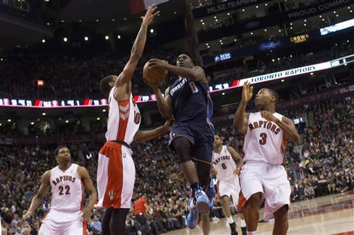 Johnson has 21 rebounds as Raptors beat Bobcats