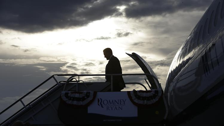 Republican presidential candidate and former Massachusetts Gov. Mitt Romney arrives in West Palm Beach, Fla., for private campaign fundraising events, Thursday, Sept. 20, 2012. (AP Photo/Charles Dharapak)