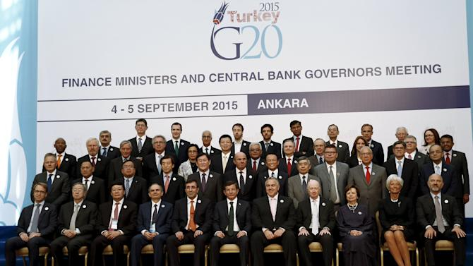 Turkey's Prime Minister Davutoglu, finance ministers and central bank governors gather for a group photo of the G20 Finance Ministers and Central Bank Governors in Ankara