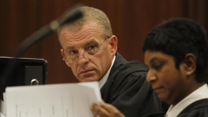 State prosecutor Gerrie Nel, prepares for a hearing in the Pretoria, South Africa high court, Thursday, March 28, 2013. The state is opposing the relaxation of bail conditions in the charges against athlete Pistorius who is charged with the shooting death of his girlfriend Reeva Steenkamp last month. (AP Photo/Denis Farrell)