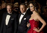 "L-R: British actors Ralph Fiennes, Daniel Craig and French actress Berenice Marlohe pose as they arrive to attend the royal world premiere of the new James Bond film 'Skyfall' at the Royal Albert Hall in London. Craig thrilled James Bond fans in London when he stepped onto the red carpet for the world premiere of the 23rd Bond film ""Skyfall"""