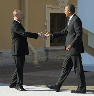"FILE - In this Sept. 5, 2013, President Barack Obama reaches to shakes hands with Russia's President Vladimir Putin during arrivals for the G-20 summit in St. Petersburg, Russia. Obama welcomed an agreement reached with Russia Saturday, Sept. 14, 2013, to secure and destroy Syria's chemical weapons stockpile, but warned that the U.S. remains prepared to act if the attempt at a diplomatic solution fails. ""I welcome the progress made between the United States and Russia through our talks in Geneva, which represents an important, concrete step toward the goal of moving Syria's chemical weapons under international control so that they may ultimately be destroyed,"" Obama said Saturday. (AP Photo/Pablo Martinez Monsivais, Pool File)"