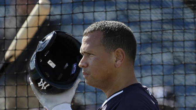 New York Yankees' Alex Rodriguez puts on his helmet during batting practice before a spring training baseball exhibition game against the Philadelphia Phillies, Wednesday, March 4, 2015, in Tampa, Fla. (AP Photo/Lynne Sladky)