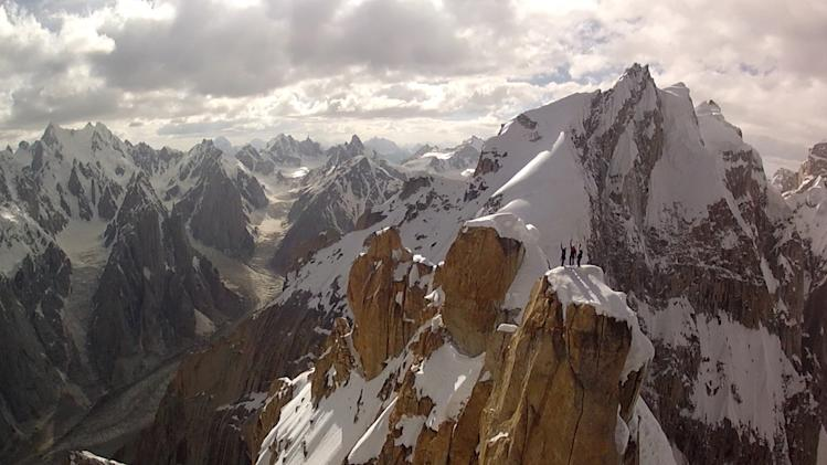 In this July 2012 photo taken from a camera mounted to a remote-controlled helicopter and provided by Remo Masina, Peter Ortner, Corey Rich and David Lama stand atop the Trango Summit in northern Pakistan's Karakoram mountain range. Drones have long been the domain of the U.S. military, which uses them extensively in Pakistan's tribal areas near the Afghanistan border to spy on and target threats to the United States. Recently, however, civilians have increasingly turned to drones to shoot ground-breaking footage or angles of adventure sports. (AP Photo/Remo Masina for Mammut)