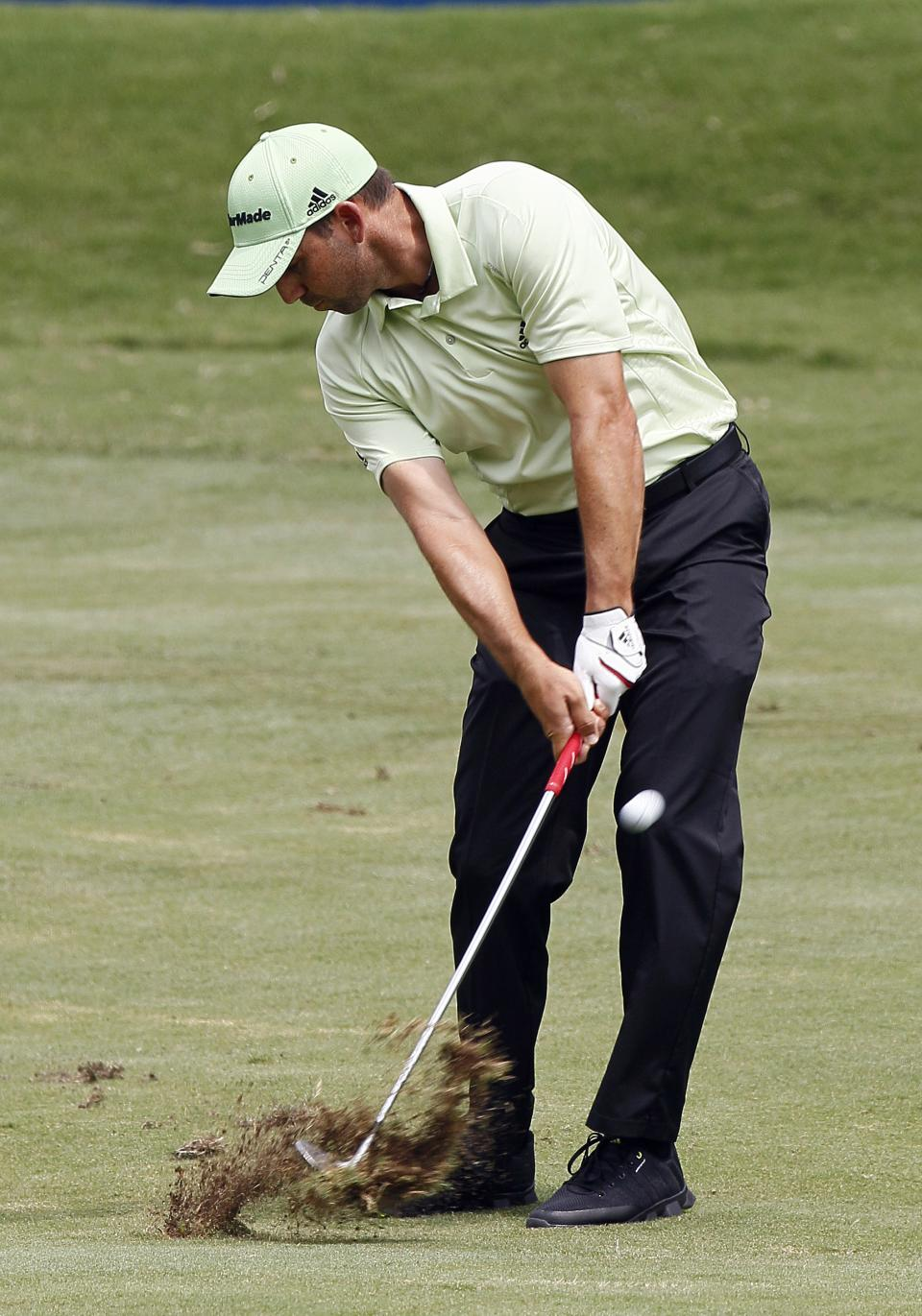 Sergio Garcia, of Spain, hits from the first fairway during the third round of the Wyndham Championship golf tournament in Greensboro, N.C., Saturday, Aug. 18, 2012. (AP Photo/Gerry Broome)