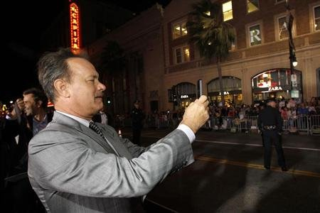 Cast member Tom Hanks photographs fans at the premiere of &quot;Cloud Atlas&quot; at the Grauman&#39;s Chinese theatre in Hollywood, California October 24, 2012. The movie opens in the U.S. on October 26. REUTERS/Mario Anzuoni