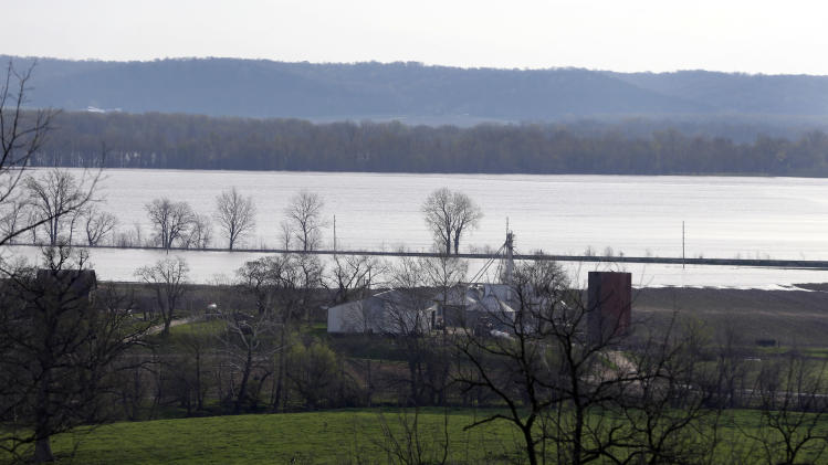 Floodwater from the Mississippi River spreads across farmland Sunday, April 21, 2013, near Clarksville, Mo. Many have come to the aid of the tiny community, working since Wednesday to build a makeshift sandbag levee that seemed to be holding as the crest, expected to be 11 feet above flood stage, approaches. (AP Photo/Jeff Roberson)