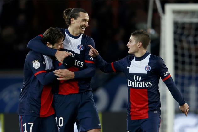 Paris St Germain's Ibrahimovic celebrates between Maxwell and Verratti after he scored against FC Sochaux during their French Ligue 1 soccer match at the Parc des Princes Stadium in Paris