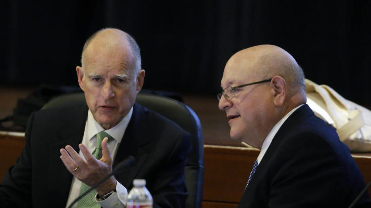 "In this Wednesday Jan. 16, 2013 photo, University of California President Mark Yudof, right, talks with California Gov. Jerry Brown, left, during a meeting of the UC Board of Regents in San Francisco. University of California President Mark Yudof said Friday Jan. 18, 2013 that he plans to step down as head of one of the nation's leading systems of higher education, citing a ""spate of taxing health issues."" Yudof, 68, said he will end his tenure on Aug. 31, about five years after he became the 19th president of the 10-campus system. The former law professor plans to return to teaching law on the UC Berkeley campus. (AP Photo/Eric Risberg)"