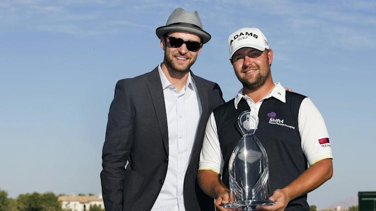 Ryan Moore, right, poses for a photo with Justin Timberlake after winning the Justin Timberlake Shriners Hospitals for Children Open golf tournament, Sunday, Oct. 7, 2012, in Las Vegas. Moore finished with a 5-under 66 for a one-stroke victory over Brendon de Jonge. (AP Photo/Julie Jacobson)