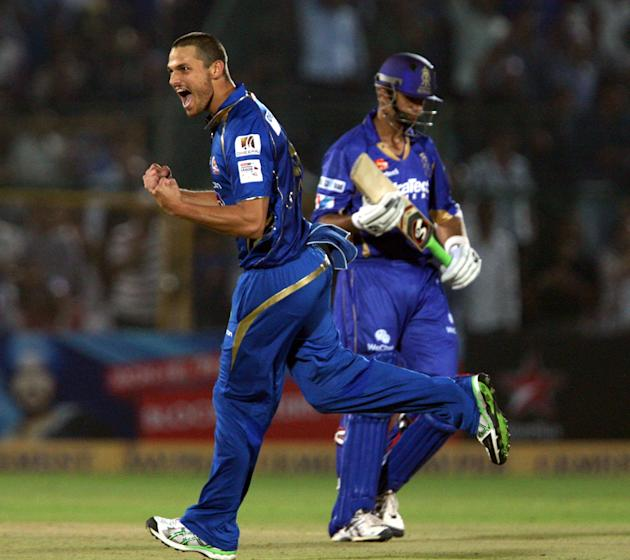 Mumbai Indians bowler Nathan Coulter-Nile celebrate fall of Rahul Dravid's wicket during the CLT20 match against Rajasthan Royals at Sawai Mansingh Stadium, Jaipur on Sept. 21, 2013. (Photo: IANS)