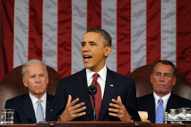President Barack Obama delivers his State of the Union address on Capitol Hill in Washington, Tuesday, Jan. 24, 2012. Listen in back are Vice President Joe Biden and House Speaker John Boehner, right. (AP Photo/Saul Loeb, Pool)