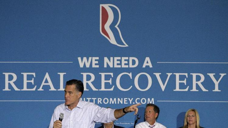 Republican presidential candidate, former Massachusetts Gov. Mitt Romney speaks at a campaign rally, Wednesday, Sept. 26, 2012, in Westerville, Ohio. Ohio Gov. John Kasich is second from right. (AP Photo/Jay LaPrete)