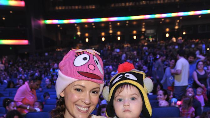 Alyssa Milano, left, and son Milo Bugliari attend Yo Gabba Gabba! Live!: Get The Sillies Out! 50+ city tour kick-off performance on Thanksgiving weekend at Nokia Theatre L.A. Live on Friday Nov. 23, 2012 in Los Angeles. (Photo by John Shearer/Invision for GabbaCaDabra, LLC./AP Images)