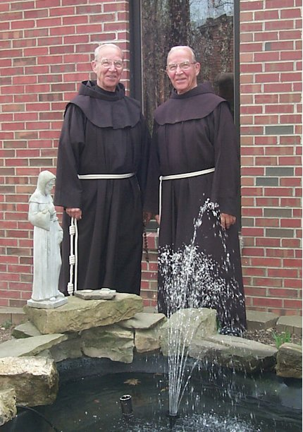 This May 2003 photo provided by St. Bonaventure University shows Adrian, left, and Julian Riester, identical twins and brothers in the Order of Friars Minor , outside the St. Bonaventure Friary in St. Bonaventure, N.Y. The twins, born just seconds apart in Buffalo on March 27, 1919, died just hours apart on Wednesday, June 1, 2011, at St. Anthony Hospital in St. Petersburg, Fla. Professed Franciscan friars for 65 years, they worked together at the St. Bonaventure Friary. (AP Photo/St. Bonaventure University, Beth Eberth)