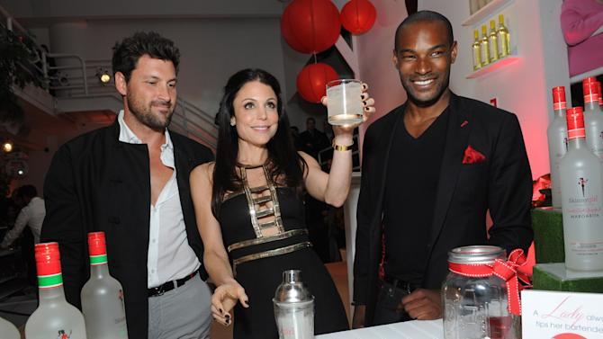 "IMAGE DISTRIBUTED FOR SKINNYGIRL COCKTAILS - Bethenny Frankel raises her glass of Skinnygirl Mojito with fellow celebrity mixologists  Maksim Chmerkovskiy, left, and Tyson Beckford, right, as they debut four new products at the Skinnygirl Cocktails ""Meet the New Girls"" launch party, Thursday, April 18, 2013 in New York. Frankel and her guest mixologists helped welcome the new girls, Skinnygirl Mojito, Skinnygirl Sweet 'n Tart Grapefruit Margarita, Skinnygirl White Cherry Vodka and Skinnygirl Moscato. (Diane Bondareff/Invision for Skinnygirl Cocktails/AP Images)"