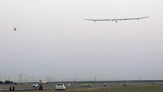 Bertrand Piccard, pilot of the Solar Impulse plane, takes off on a multi-city trip across the United States from Moffett Field NASA Ames Research Center in Mountain View, Calif., Friday, May 3, 2013. Solar Impulse, considered the world's most advanced solar-powered plane, will stop for seven to 10 days at major airports in each city, so the pilots can display and discuss the aircraft with reporters, students, engineers and aviation fans. It plans to reach New York's Kennedy Airport in early July — without using a drop of fuel, its creators said. (AP Photo/Tony Avelar)