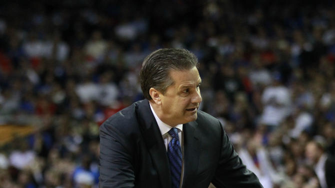 Kentucky head coach John Calipari reacts in the first half of an NCAA college basketball game against  Duke  in Atlanta, Tuesday, Nov. 13, 2012. (AP Photo/John Bazemore)