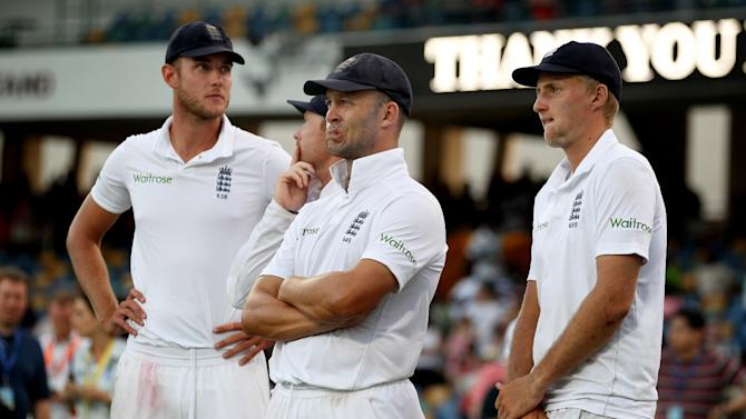 Cricket: England's Stuart Broad, Jonathan Trott and Joe Root look dejected during the post match presentations