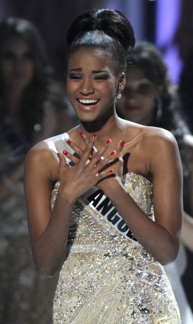 ALTERNATIVE CROP OF XAP114 - Miss Angola Leila Lopes reacts after being named Miss Universe 2011, before being crowned at the Miss Universe pageant in Sao Paulo, Brazil, Monday Sept. 12, 2011. (AP Pho