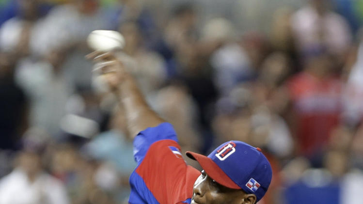 Dominican Republic's Samuel Deduno pitches against the United States during the second inning of a second-round game of the World Baseball Classic in Miami, Thursday, March 14, 2013. (AP Photo/Wilfredo Lee)