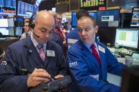Traders work on the floor of the New York Stock Exchange shortly after the opening bell