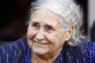 British novelist Doris Lessing is seen smiling on the doorstep of her house, after she had won the 2007 Nobel Prize for literature, in London in this October 11, 2007 file photograph. Lessing died on November 17, 2013, her publisher said on Sunday. REUTERS/Kieran Doherty/Files (BRITAIN) - RTR1UT2Y (SOCIETY PROFILE )