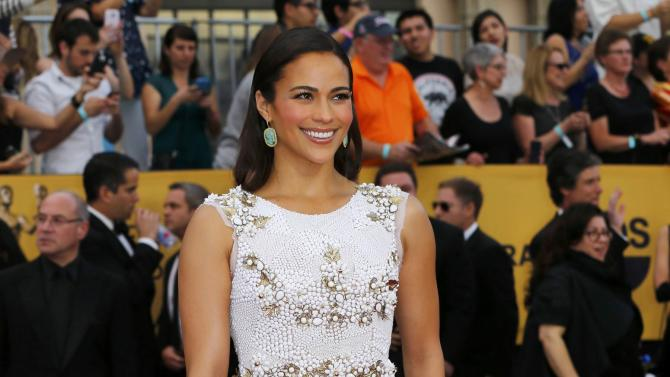 Actress Paula Patton poses on arrival at the 21st annual Screen Actors Guild Awards in Los Angeles