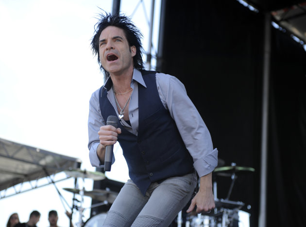 "FILE - In this May 21, 2011 file photo, Patrick Monahan of the rock group Train performs at Pimlico Race Course in Baltimore. Train, Christina Aguilera, Michael Buble, and Dave Matthews are among the acts helping Special Olympics celebrate the 25th anniversary of its ""A Very Special Christmas"" album series. Two albums will be released Oct. 16 to celebrate the partnership, which has raised more than $100 million for Special Olympics. (AP Photo/Nick Wass, File)"