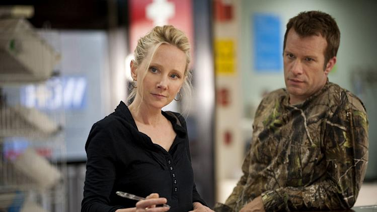 "Anne Heche as Jessica and Thomas Jane as Ray in ""Hung."""