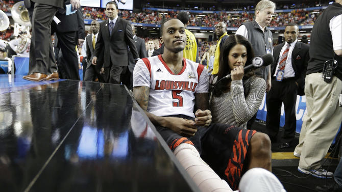 Louisville's Kevin Ware sits on the bench at the court before the first half of the NCAA Final Four tournament college basketball semifinal game against Wichita State, Saturday, April 6, 2013, in Atlanta. (AP Photo/David J. Phillip)