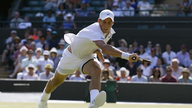 Vasek Pospisil of Canada returns the ball to James Ward of Britain during their singles match at the All England Lawn Tennis Championships in Wimbledon, London, Saturday July 4, 2015. (AP Photo/Kirsty Wigglesworth)