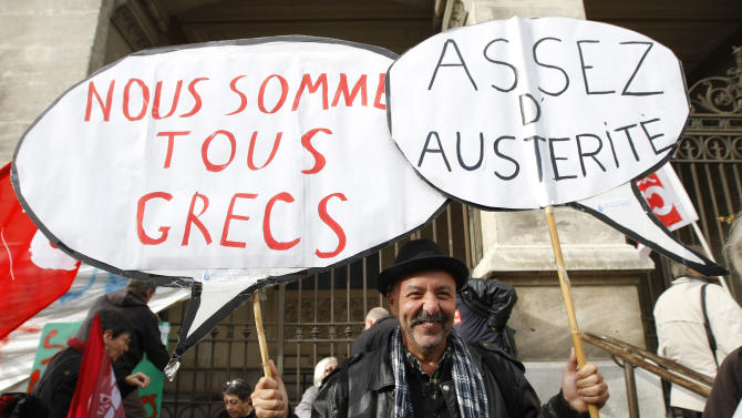 "Worker holds  placards reading "" , We are all Greek, enough austerity"" , during a demonstration against austerity, in Marseille, southern France,  Wednesday, Nov. 14, 2012.  With rampant unemployment spreading misery in southern Europe and companies shutting factories across the continent, workers around the European Union sought to unite in a string of strikes and demonstrations on Wednesday, with strikes and protests planned in Italy, Greece, Portugal, France and Belgium. (AP Photo/Claude Paris)"