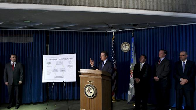 Preet Bharara (C), U.S. Attorney for the Southern District of New York, speaks to the media during a news conference in New York