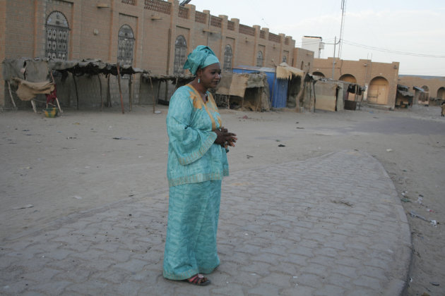 In this Monday, Feb. 4, 2013 photo, Salaka Djicke stands in the town square where she was publicly whipped after being caught having a relationship with a married man, in Timbuktu, Mali. Until they we