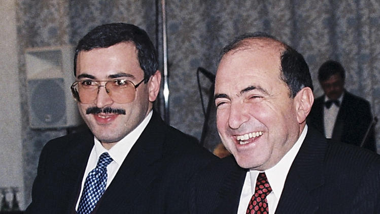 FILE -In this undated file photo, Boris Berezovsky, right, and Mikhail Khodarkovsky, two of Russia's most prominent tycoons, smile at a reception in Moscow. United Kingdom police have said that Berezovsky has been found dead Saturday March 23, 2013.(AP Photo/Alexei Kondratyev, file)