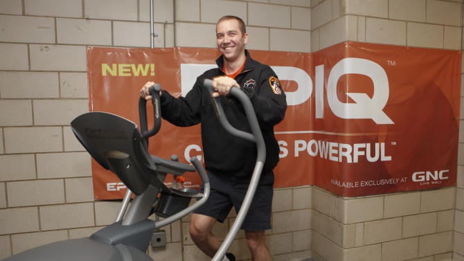 IMAGE DISTRIBUTED FOR EPIQ - FDNY Brian Collier works out on EPIQ and GNC donated gym equipment to FDNY Engine 4, Ladder 15 on Tuesday, Feb. 5, 2013 in New York City. (Photo by Amy Sussman/Invision for EPIQ/AP Images)