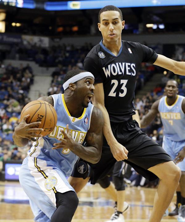 Denver Nuggets' Ty Lawson, left, drives around Minnesota Timberwolves' Kevin Martin in the second half of an NBA basketball game on Wednesday, Nov. 27, 2013, in Minneapolis. Lawson led the Nuggets wit