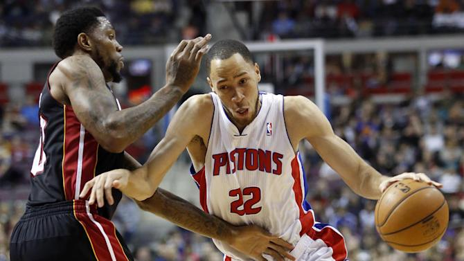 Detroit Pistons forward Tayshaun Prince (22) drives against Miami Heat forward Udonis Haslem during the first half of an NBA basketball game Friday, Dec. 28, 2012, in Auburn Hills, Mich. (AP Photo/Duane Burleson)