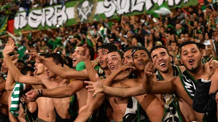 Supporters of Morocco's Raja Casablanca celebrate after their team won their FIFA Club World Cup semi-final against Brazil's Atletico Mineiro in the Moroccan city of Marrakesh, on December 18, 2013