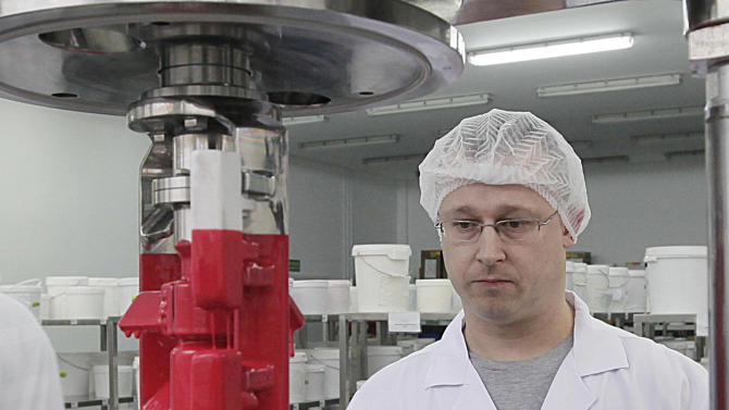 In this Feb. 14, 2013 photo, an Inglot employee works in the production facility for the cosmetics company in Przemysl, Poland. Inglot and some Muslims say the company's O2M breathable nail polish is the first of its kind because it lets air and moisture pass through to the nail. A craze has built up around it with Muslim women in recent months after an Islamic scholar in the United States tested its permeability and published an article saying that, in his view, it complies with Muslim law.   (AP Photo/Czarek Sokolowski)