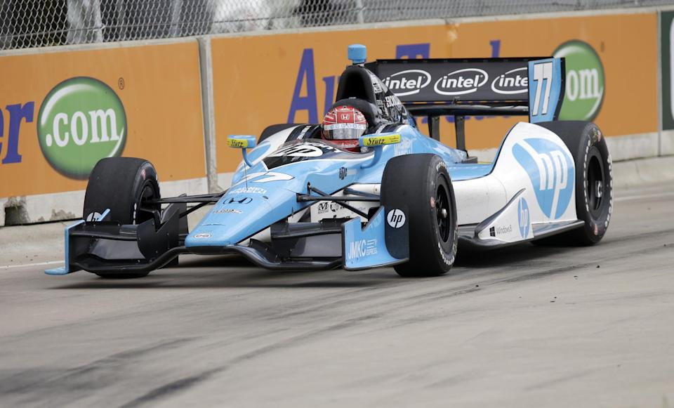 Simon Pagenaud of France takes the eighth turn during the IndyCar Detroit Grand Prix auto race on Belle Isle in Detroit, Sunday, June 2, 2013. (AP Photo/Carlos Osorio)